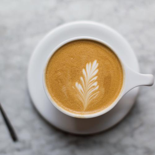 Latte art at Dooby's brunch spots.