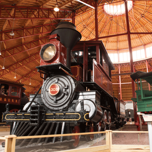 A black train from below at The B and O Museum in Baltimore.