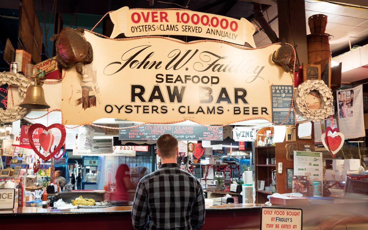Customers ordering at Faidleys Lexington Market in Baltimore.
