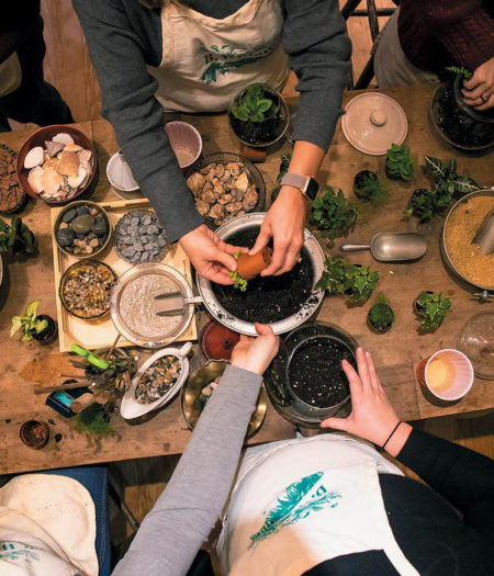 A potting class from above of people's hands and arms as they make at B Willow Shop in Baltimore.