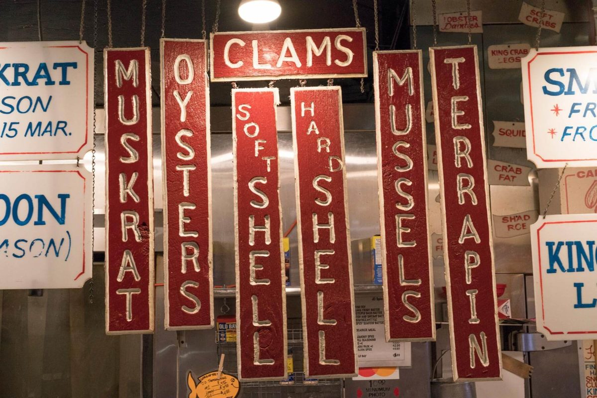 Red and white hand crafted vintage signage at Faidleys in Lexington Market in Baltimore.