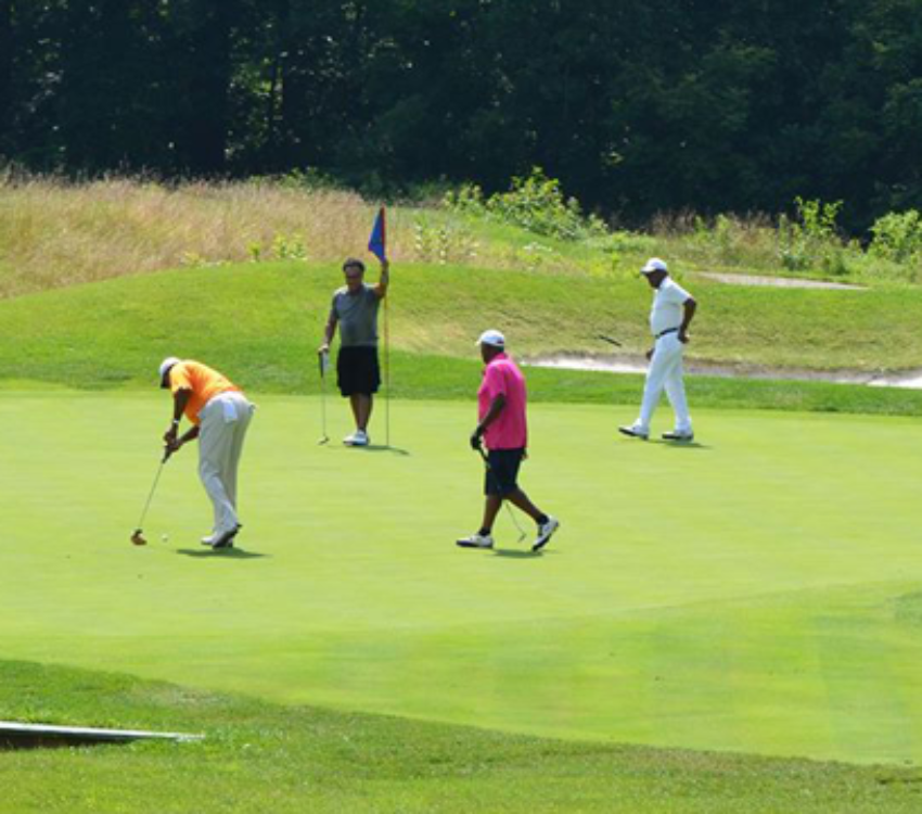 A group of men playing golf