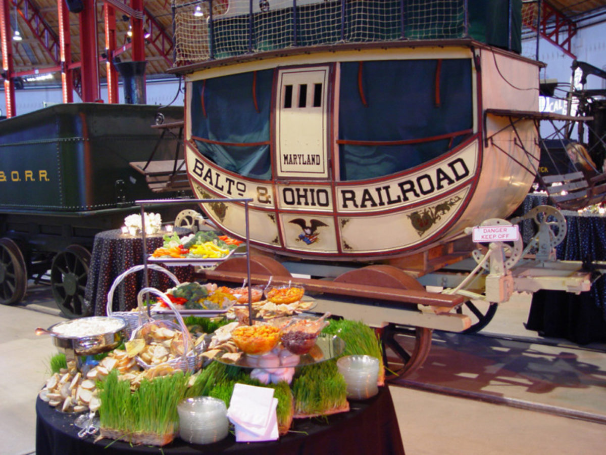 Food table in front of a horse drawn carriage at the B&O Railroad Museum.