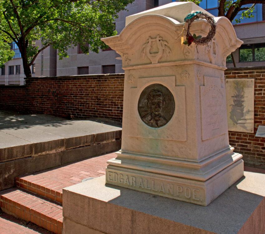 Edgar Allen Poe's gravestone on a sunny day.