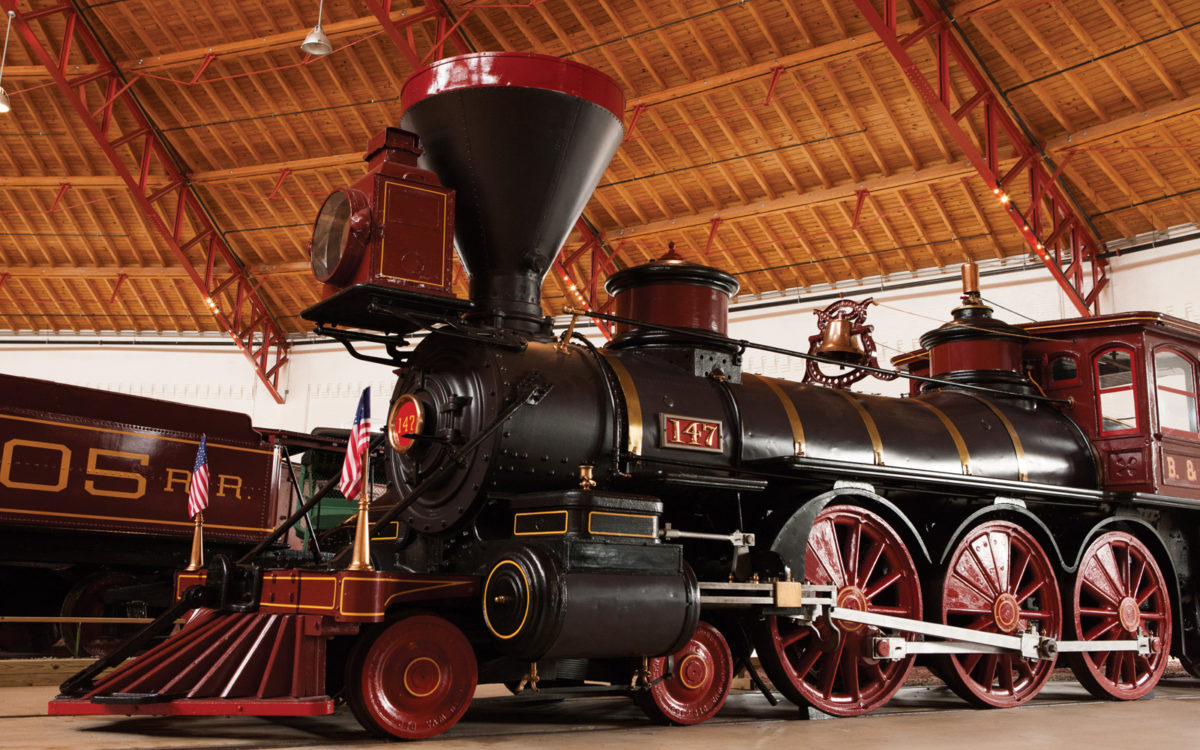 The front of B&O No. 147, a black and red steam train inside the B&O Railroad Museum.