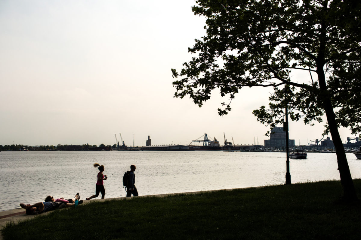 People running along waterfront